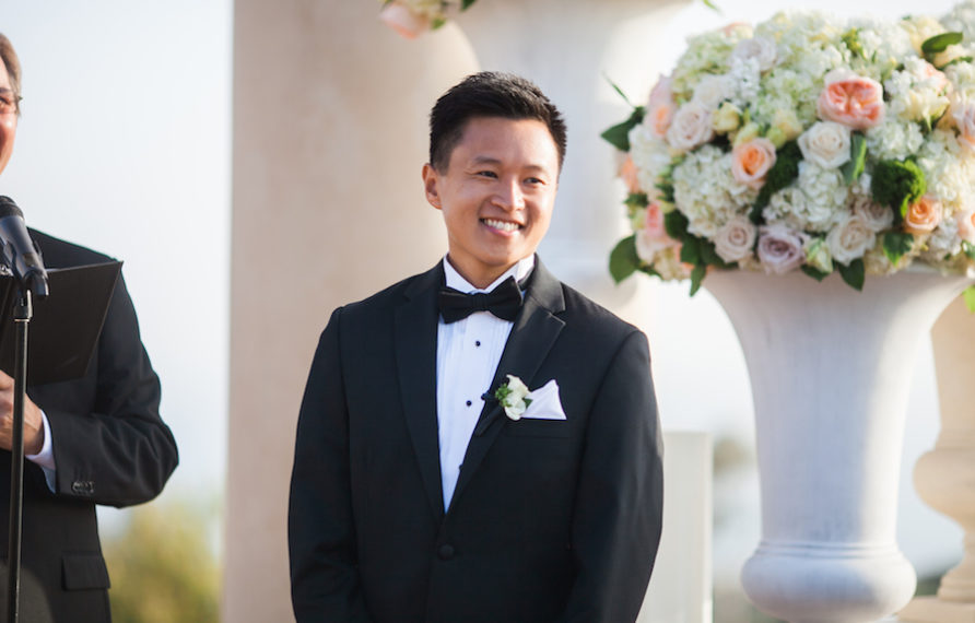 10-pelican-hill-wedding-by-kim-le-photography-ceremony-groom-892x594