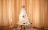 22-pelican-hill-wedding-by-kim-le-reception-details-wedding-cake-892x594