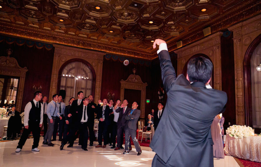 26-millennium-biltmore-wedding-by-chris-of-lin-jirsa_reception-details-garter-toss-892x594