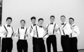 4-pelican-hill-wedding-by-kim-le-photography-groom-portraits-groomsmen-suspenders-bowties-892x594